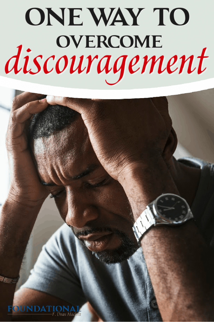 discouraged person with head in hands