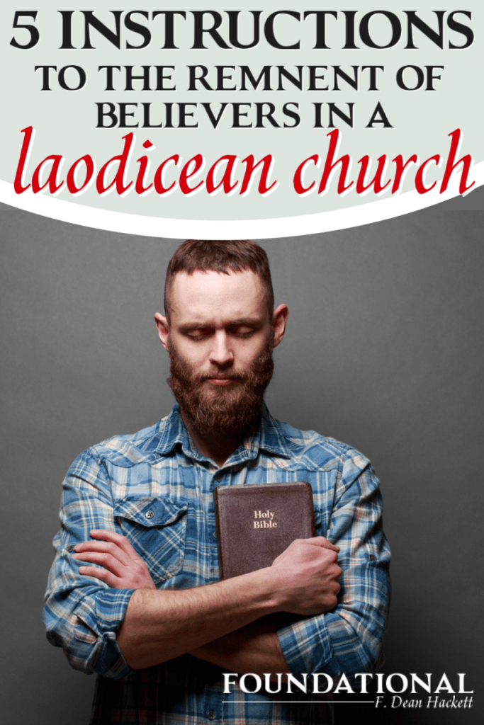 Man with a beard holding a Bible
