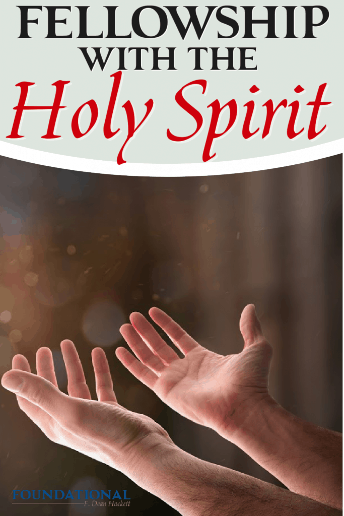 Person's hands held out in prayer