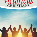 group of people holding victory hands at sunrise