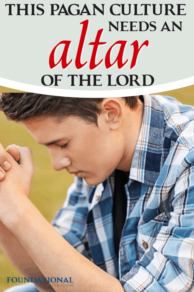 young man hands folded in prayer