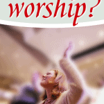 woman raising hand worshiping in Church